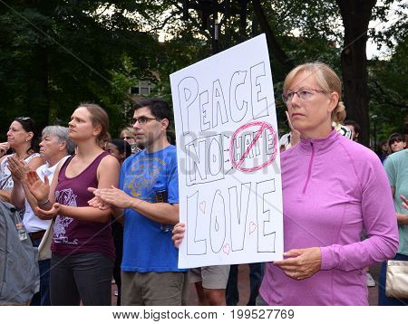 ANN ARBOR MI - AUG 13: A woman holds up a sign at a rally in solidarity with the counter-protesters of Charlottesville VA in Ann Arbor MI on August 13 2017.