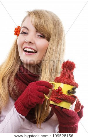 Smiling Girl With Rowan In Hair Wearing Gloves And Holding Cup Of Tea With Woolen Scarf And Cap