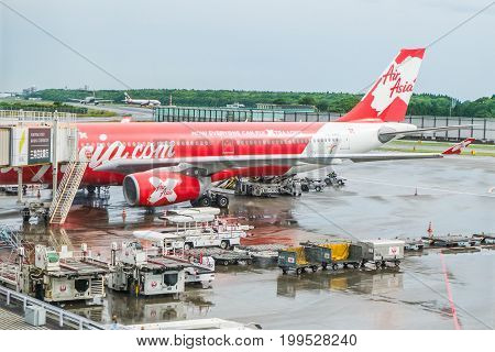 TOKYO, JAPAN - JUNE 18 2017 : Airasia X Airbus A330-343 (PK-XRC) waiting for boarding passenger from terminal at narita international airport