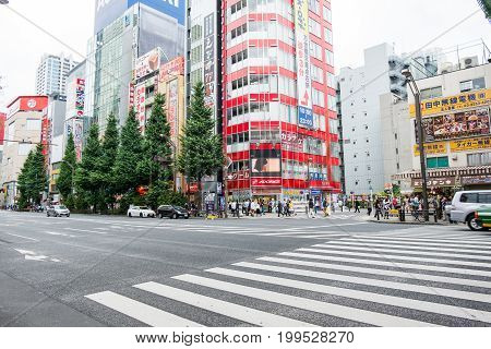 TOKYO, JAPAN - JUNE 18 2017 : pedestrians crossing the road on zebra crosswalk in akihabara shopping area