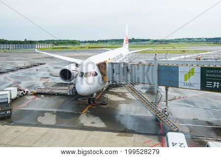 TOKYO, JAPAN - JUNE 18 2017 : Japan Airlines Boeing 787 waiting for boarding passenger from terminal at narita international airport
