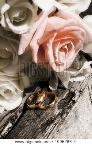 Bunch Of Flowers And Gold Rings On Old Wood