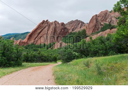 along a hiking trail through the valley at roxborough state park in douglas county colorado