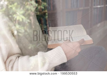 Vintage Tone Of Asia Woman Reading Book In Library