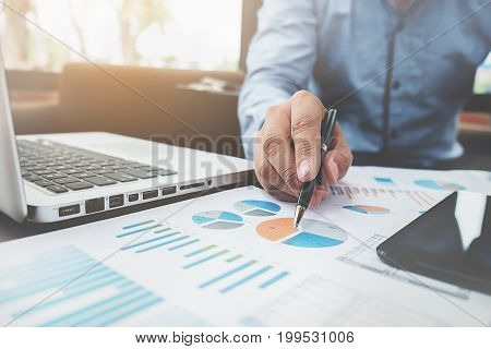 Business Man Working With Laptop And Documents On His Desk. Business Concept