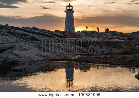 Peggys cove visitors at end of day light