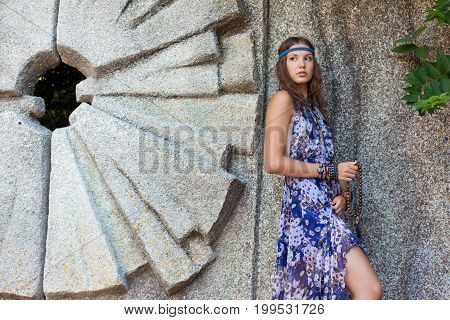 Woman In A Sundress At The Stone Wall