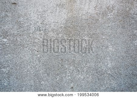 Gray concrete wall with fine texture and scratches