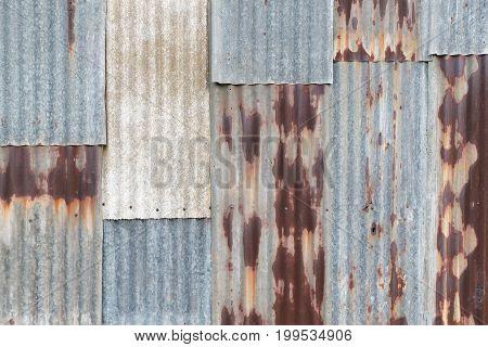 Old Rusty Corrugated Tin Zinc Metal Wall In Vintage Tone.