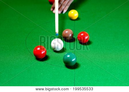 Snooker Player Being Ready To Hit The White Ball