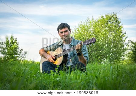 Handsome Man Playing On Acoustic Guitar