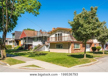 Street of residential houses on sunny day in Vancouver BC