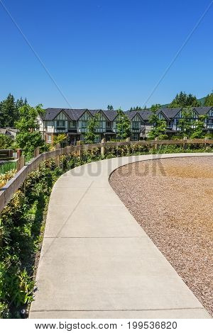 Convenient concrete walkway along the row of new townhouses