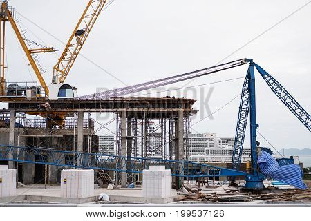 Building construction site, with crane and construction machine