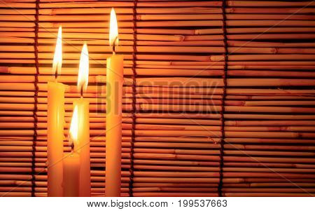 Group Of Candle Light On Blurred Old Wooden Background At The Night. Selective Focus On Tha Candle W
