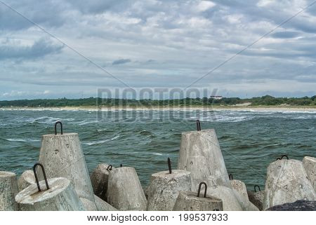 An Embankment Of Baltic Sea At The City Baltiysk On Cloudy Summer Day, A View To A Beach And Big Sto