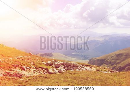 Toned Panoramic View Over The Carpatian Mountains, Green Valleys And Beautiful Blue Sky At The Backg