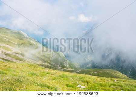 Panoramic View Over The Carpatian Mountains, Serpentine Path And A Big Fog Cloud At The Background,