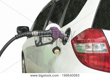 Car stopping and refueling on a petrol station