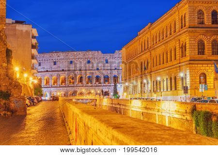 Beautiful Landscape Of The Colosseum In Rome Through Street Via Degli Annibaldi  In The Night Time.