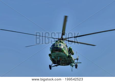 Russian Military Helicopter Mi-8 In The Cloudy Sky