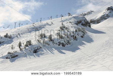Ski resort lift and slopes in winter