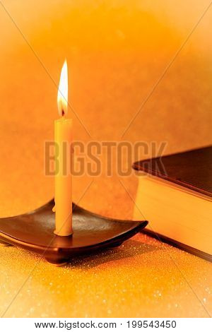 Still Life Golden Candle Light And Bible Book On Golden Blurred Bokeh Background. ,abstract Backgrou