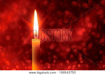 Abstract background for pray or meditation caption. Still life golden candle light with reflection on red blurred bokeh background.