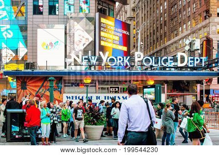 New York USA - 26 September 2016: Locals and tourists going about their business in busy Times Square outside of the NYPD Times Square Precinct.