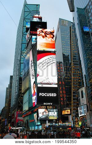 New York USA - 26 September 2016:Massive advertising screens tower above pedestrians in Times Square