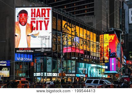 New York USA - 26 September 2016:Massive advertising Billboards tower above traffic and pedestrians at the intersection between Times Square and Broadway.