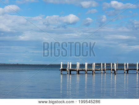 jetty on the clam water and beautiful blue sky
