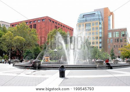 New York USA - 27 September 2016: People enjoying Washington Square Park. Washington Square Park is a 9.75-acre public park in the Greenwich Village neighborhood of Lower Manhattan New York City.