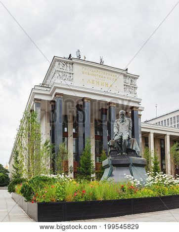Monument to famous russian writer Dostoevskiy F.M. in front of Russian State Library. Moscow Russia.
