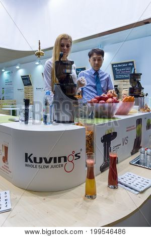 BERLIN - SEPTEMBER 04 2015: Demonstration of the juicers by Kuvinos. International radio exhibition Berlin (IFA).