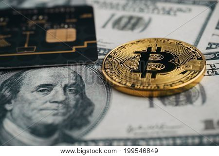 New age currency bitcoin credit card and dollar banknote new kind of money business and commercial concept