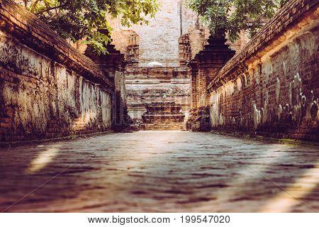 Walk Way Or Entered To Old Chapel And Pagoda With Red Brick Wall Of Wat Maheyong Temple , Ayutthaya