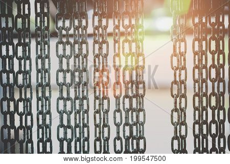Selective focus on barrier gate made of steel chain.