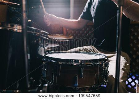 Professional drum set closeup. Drummer plays drums, live music concert