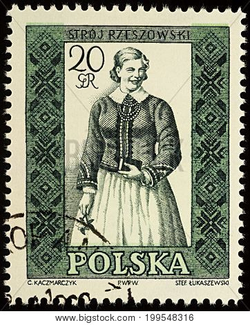 Moscow Russia - August 12 2017: A stamp printed in Poland shows woman in Polish traditional costume Rzeszow region series