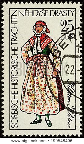 Moscow Russia - August 13 2017: A stamp printed in GDR (East Germany) shows woman in traditional costume of Klitten series