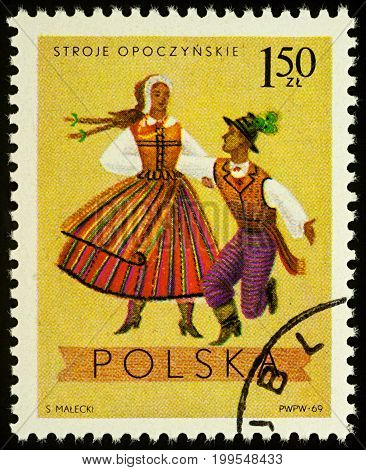 Moscow Russia - August 11 2017: A stamp printed in Poland shows dancing couple in traditional costumes from Opoczno Lodz series