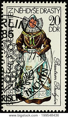 Moscow Russia - August 13 2017: A stamp printed in GDR (East Germany) shows woman in traditional costume of Bautzen series