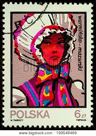 Moscow Russia - August 11 2017: A stamp printed in Poland shows young woman with Polish traditional hat Warminsko-Mazurski series