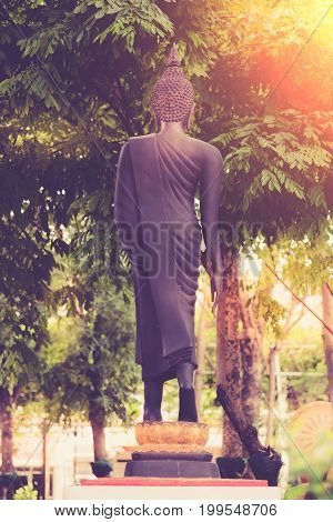 Vintage Image Style ,back View On The Standing Buddha Statue Of Temple Garden In Bangkok, Thailand