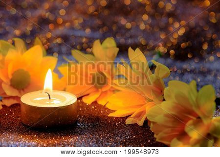 Prayer And Hope Concept. Retro Candle Light And Yellow Flower With Lighting Effect And Glitter Abstr