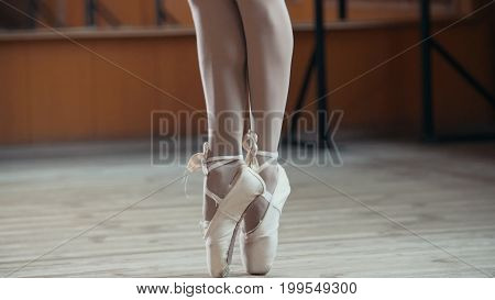 Ballet dancer's feet - point exercises, close up view