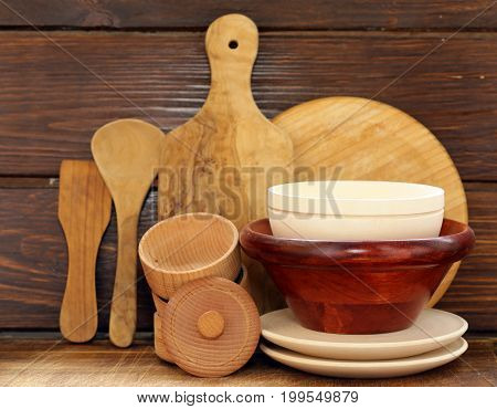 Wooden utensils, cups, plates, spoons - rustic style