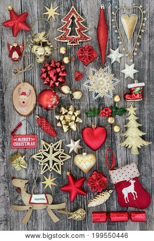 Christmas symbols with bauble decorations on rustic wood background.