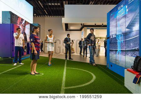 BERLIN - SEPTEMBER 04 2015: Stand of company Beko. Interactive game of football. International radio exhibition Berlin (IFA2015).